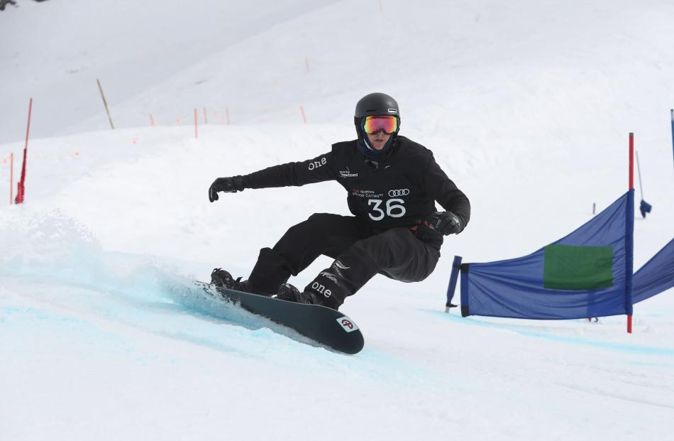 New Zealander Carl Murphy on his way to the fouth- fastest time in the world para snowboard...