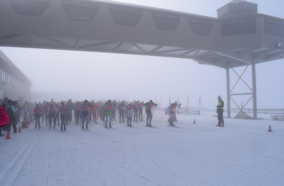 It was a foggy start to the 42km merino muster marathon at the Snow Farm on Saturday. Photo:...