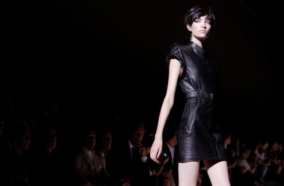 Tom Ford's collection switched between soft playful flashy dresses to ones with more of a hard, edgey look. Photo: Reuters