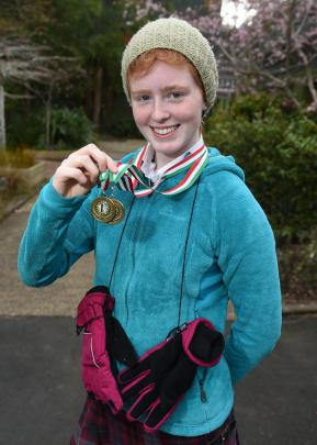 Logan Park High School luger Ella Molteno (14) with her two first-place Naseby Cup medals at the school last week. Photo: Gregor Richardson