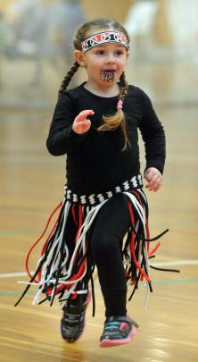 Neave Bisset (4) of Milton, strides out during her performance with Tokomairiro Early Learning Centre at 2017 Otago Polyfest yesterday. Photos: Christine O'Connor