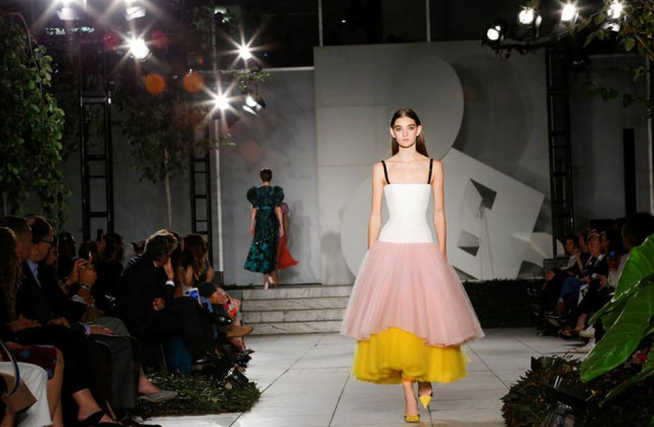 The evening dresses featured heavy satin contrasted with light tulle in soft hues. Photo: Reuters
