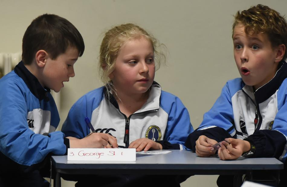 George Street Normal School pupils (from left) Mark Campbell (11), Addison Davies (10) and Sam...