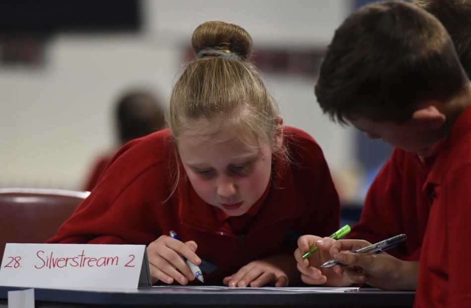Silverstream School pupils Harmony White (11, left) and Caleb Walker (9) study the questions.