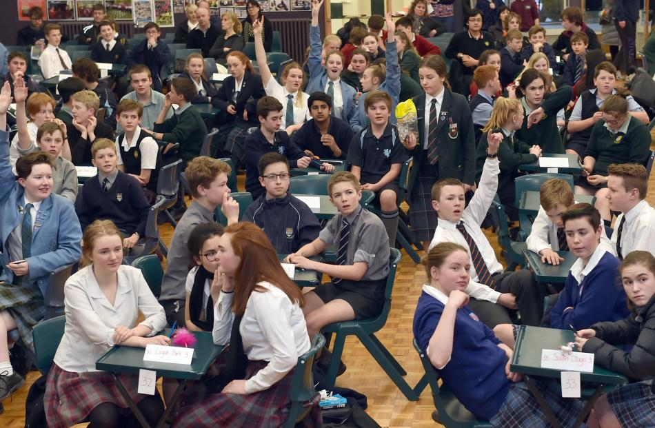 Year 9 and 10 pupils listen to a question during the Otago Daily Times Extra! quiz at Kaikorai...
