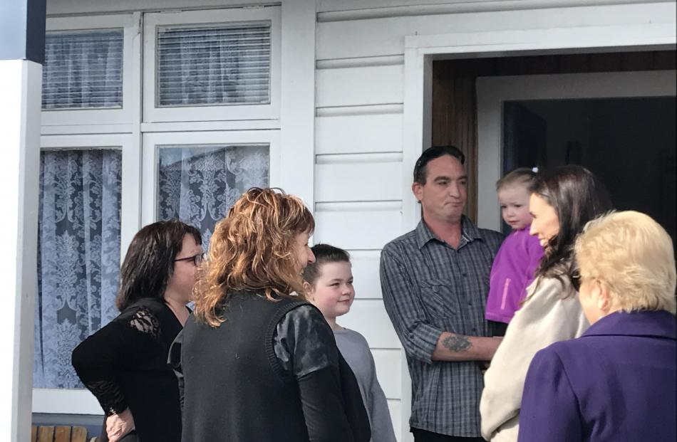 Jacinda Ardern talks to a St Kilda family who have been affected by flooding. Photo: Margot Taylor