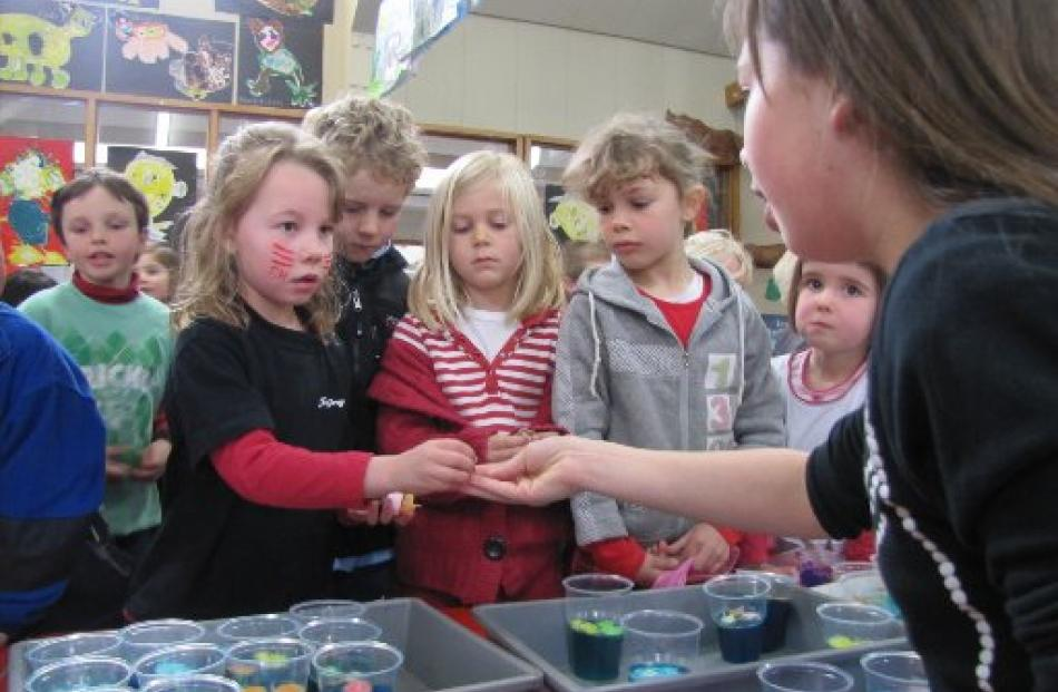 Year 1 and 2 pupils from Queenstown Primary School use their hard-earned money to raise funds.