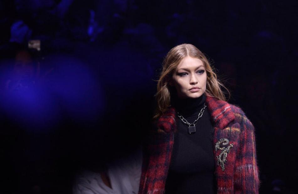 Model Gigi Hadid displays a creation from the Tommy Hilfiger Spring/Summer 2018. Photo: Reuters