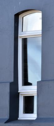 One of the windows at 123 Vogel St, Dunedin, the building's developer was called on to remove.