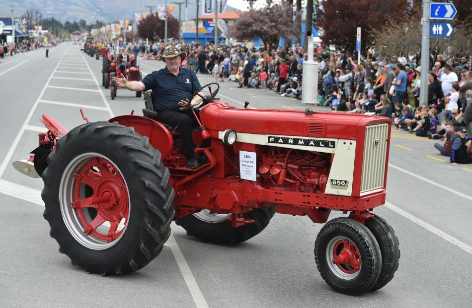 Alan McCrostie, of Alexandra, delights the crowd with his twirling tractor antics during the...