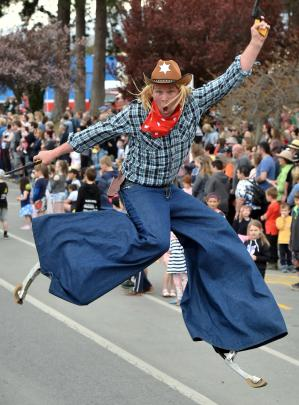 TJ Slam, a street performer, gets some air during the festival's grand parade.