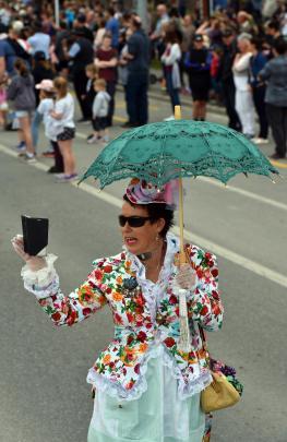Vicki Yarker-Jones, of Dunedin, films the crowd during the parade.