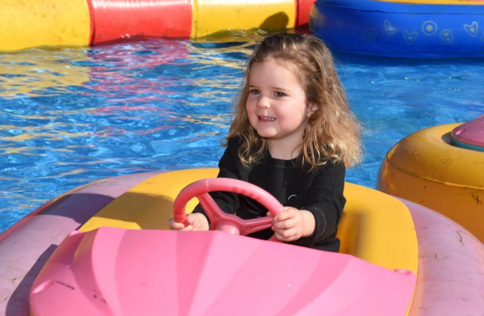 Harriet Taylor (2), of Wanaka, laps up the bumper boat action.