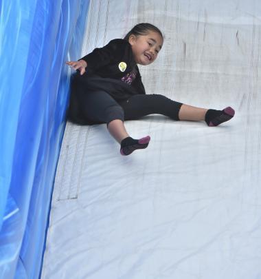 Aqua-Blu Winiata-Beazley (6), of Alexandra, giggles as she goes for a slide.