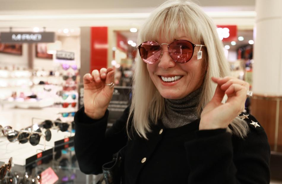 The pink lenses go well with that blonde hair Lana...at the Sunglass Hut