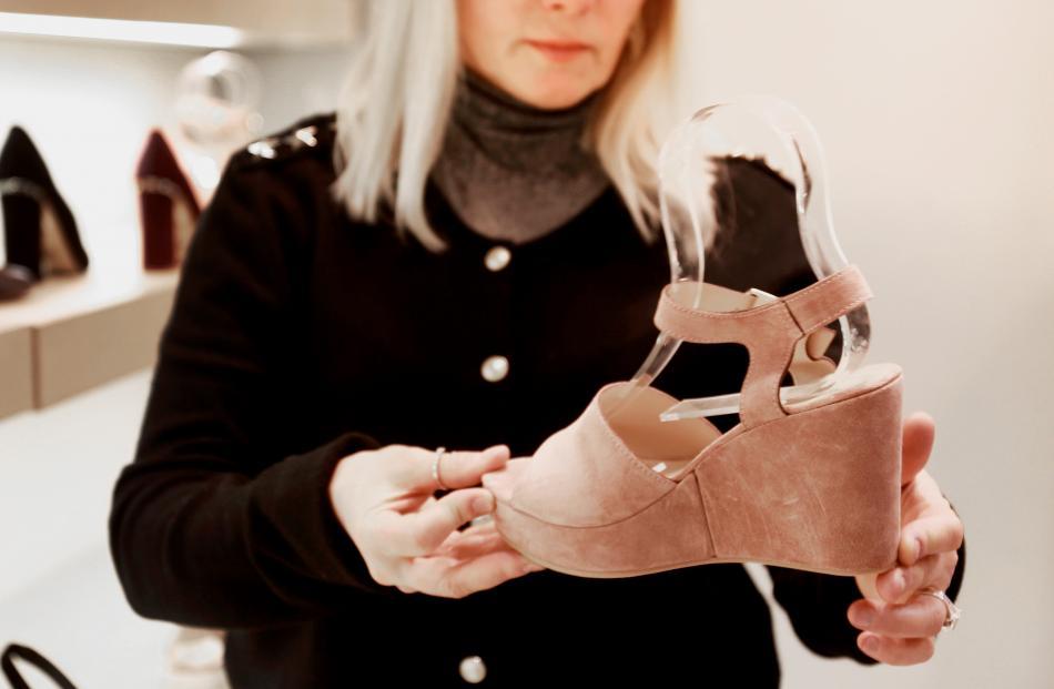 Admiring shoes at Mi Piaci