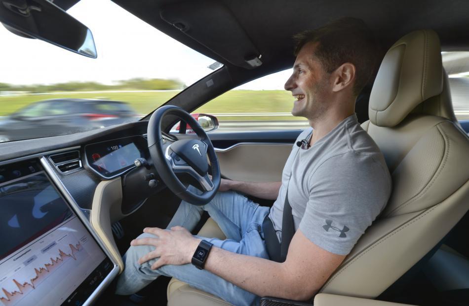 Dean Hall's Tesla Model S P100D drives him to Dunedin Airport. Photo: Gregor Richardson
