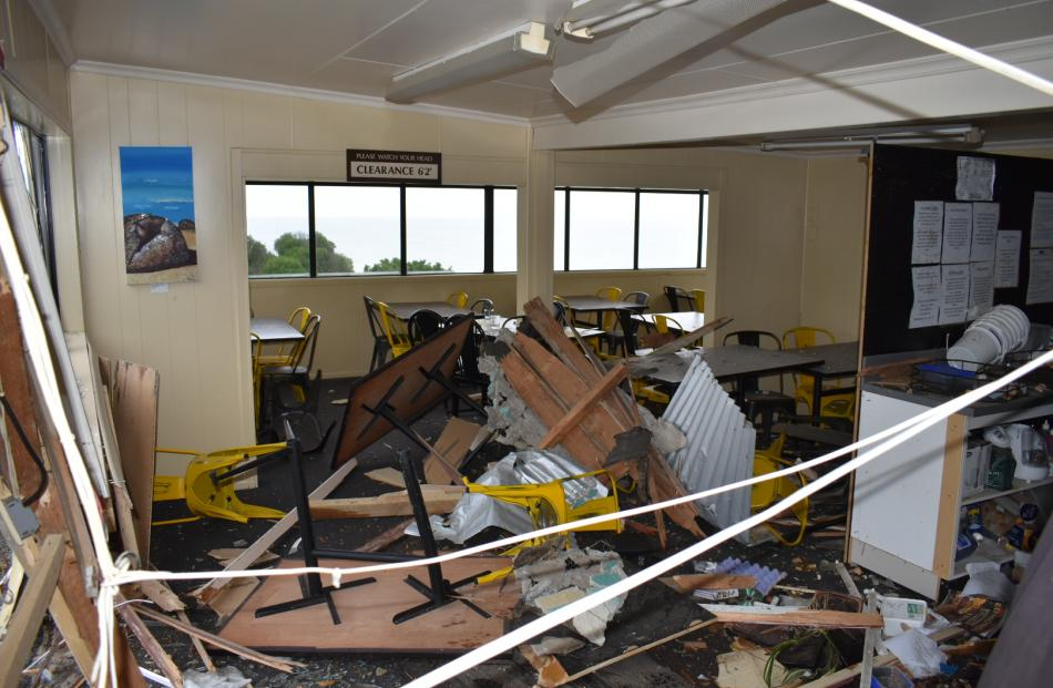Damage inside the cafe. Photo Richard Savage