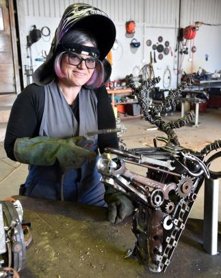Sara Gillies has mastered the art of welding to make her  metal creations out of vintage finds. Photo: Craig Baxter
