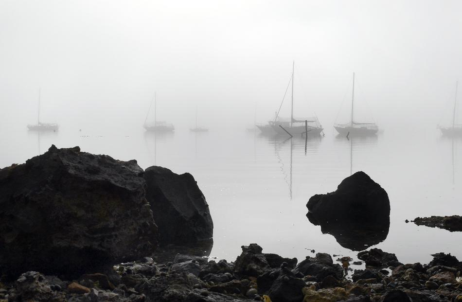 Sea fog shrouds boats at Deborah Bay. Photo: Stephen Jaquiery