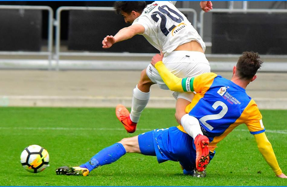 Front foot tackle by captain Conor O'Keeffe. Photos Rab Smith