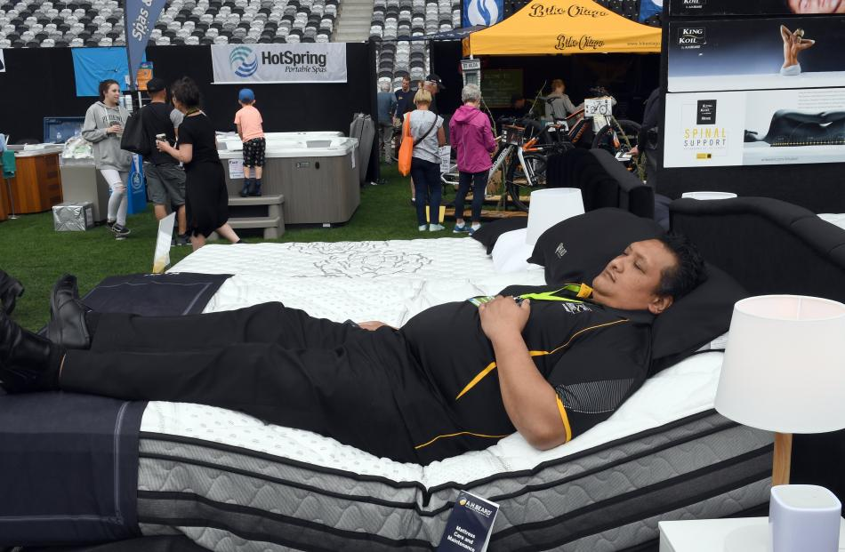 Sales rep Nafoa Tupai  caught  a few winks at the Harvey Norman stand.