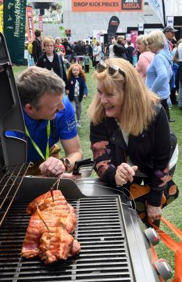 Craig Taylor, of Hunting and Fishing New Zealand, shows Christine Doig Brown, of Dunedin, a...