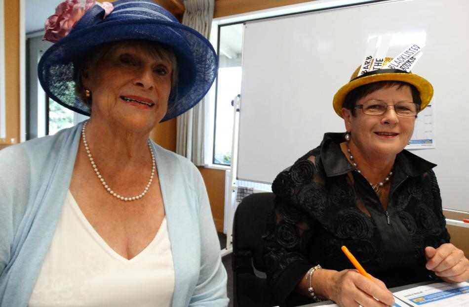 Enjoying Melbourne Cup ''Hawea Style'' at the Hawea Community Centre yesterday are Denise Brown (the Banker) and Barbara Mackenzie (Barb the Blacklisted Bookie), both of Hawea.