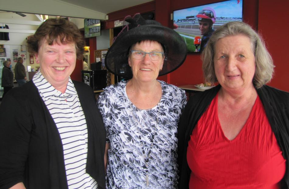 Chrissy Edwards, Muriel Templer and Win Reid, all of Cromwell, enjoy Melbourne Cup day at the Cromwell Town and Country Club.