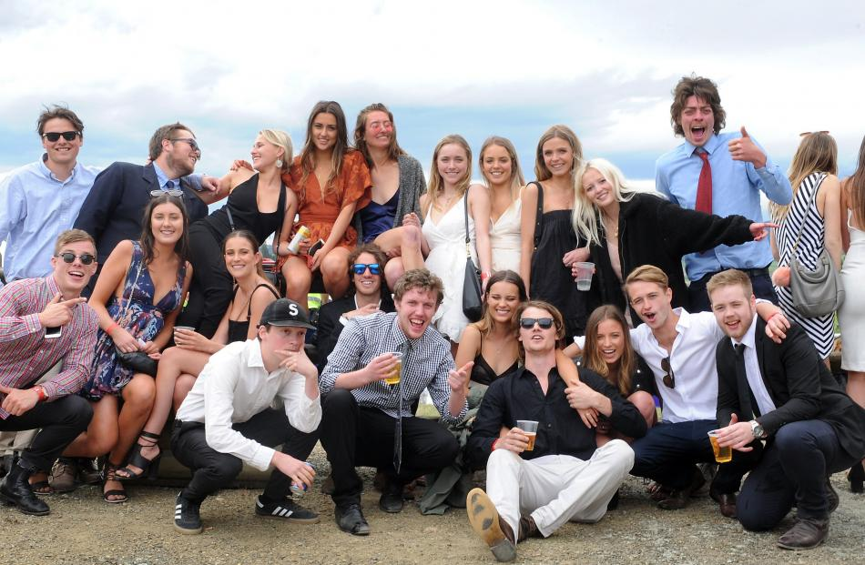 A group of young punters gather after the Melbourne Cup race was televised at the Wingatui event....
