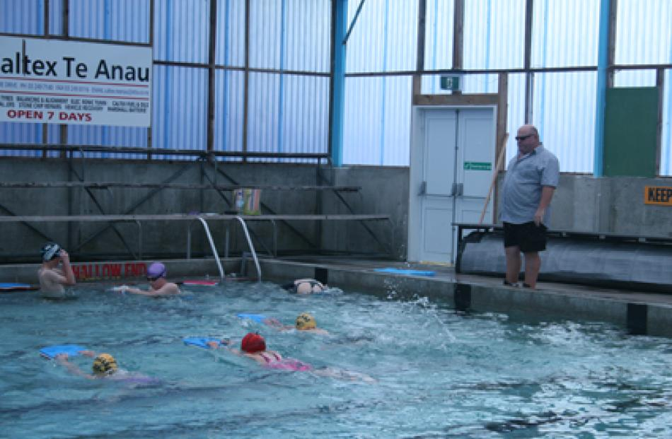 Graeme Laing with swimmers getting finer points on their training programme. Photos: Julie Walls