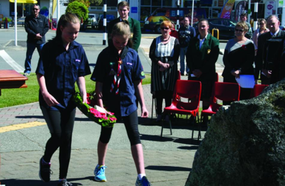 Scouting Te Anau Scouts, Molly Allan (left) and Amelija Watson laid the commemorative wreath on...