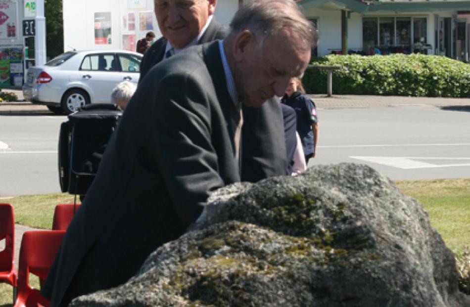 Fiordland RSA member Bob Yates  placing his poppy in commemoration at the Memorial Plaque, The...
