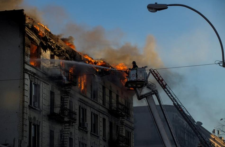 FDNY: 170 firefighters battle blaze in Upper Manhattan apartment