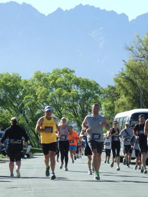 Runners pour along Park St, Queenstown, against a backdrop of The Remarkables. Photo: Guy Williams