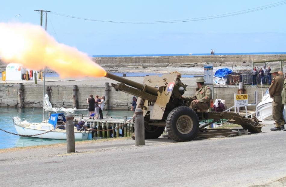 Oamaru Coastal Defence fires a 25-pounder field gun/howitzer at the Oamaru Rowing Club's rowing...