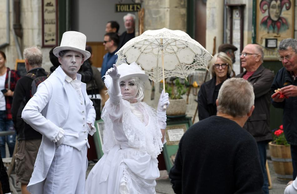 Human statues Paul Smith and Rochelle Brophy strike a pose at the Victorian celebrations. Photo:...