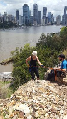 Abseiling off the Kangaroo Point cliffs.