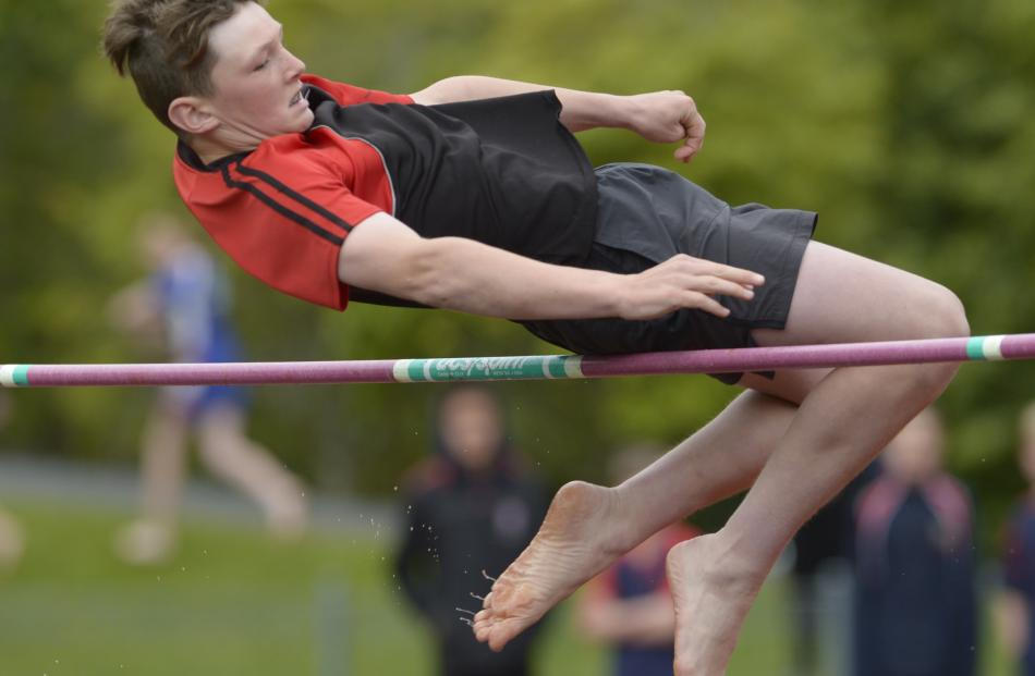 Dunedin North Intermediate's Grayson Small (13) clears the bar during the 13-and-over boys' high...
