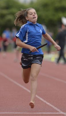 Holly Rowcroft (10) leads the field down the home straight for Kaikorai Primary School in the...