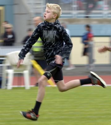 Liam Brady (11), of Outram School, competes in the boys' under-12 75m sprint.