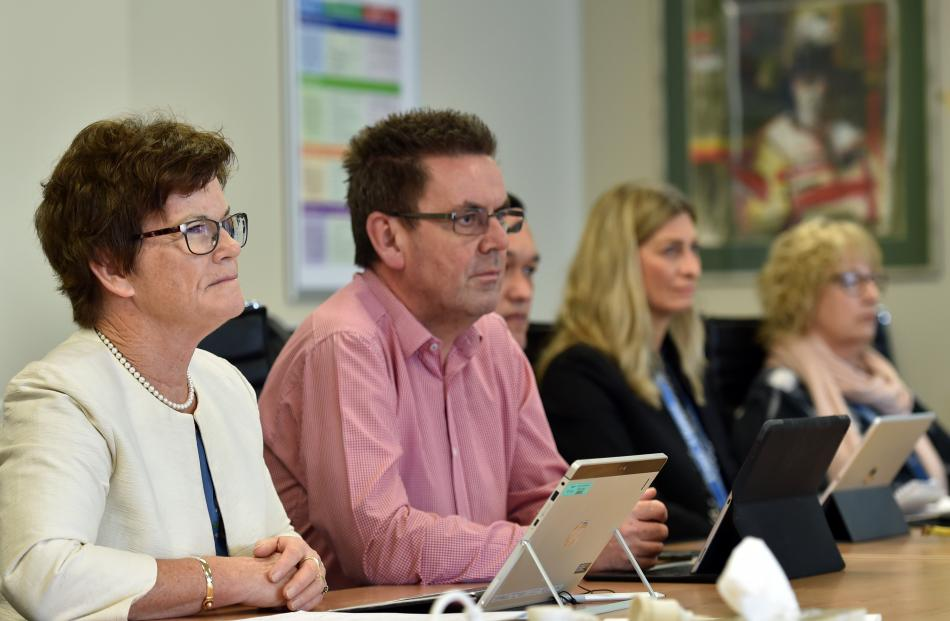 Southern District Health Board commissioner Kathy Grant and chief executive Chris Fleming listen to Jacqui Hellyer.