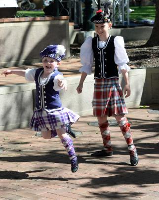 Eleanor Sammes (4) and Maddi McBride (10), both of Dunedin, practise their highland dancing...