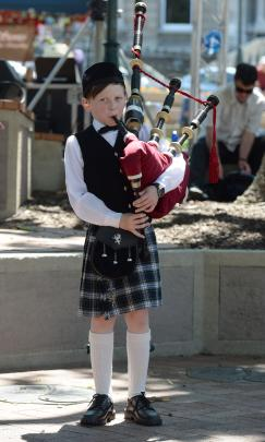 Isaac Hamilton (10) performs with the John McGlashan Pipe Band.