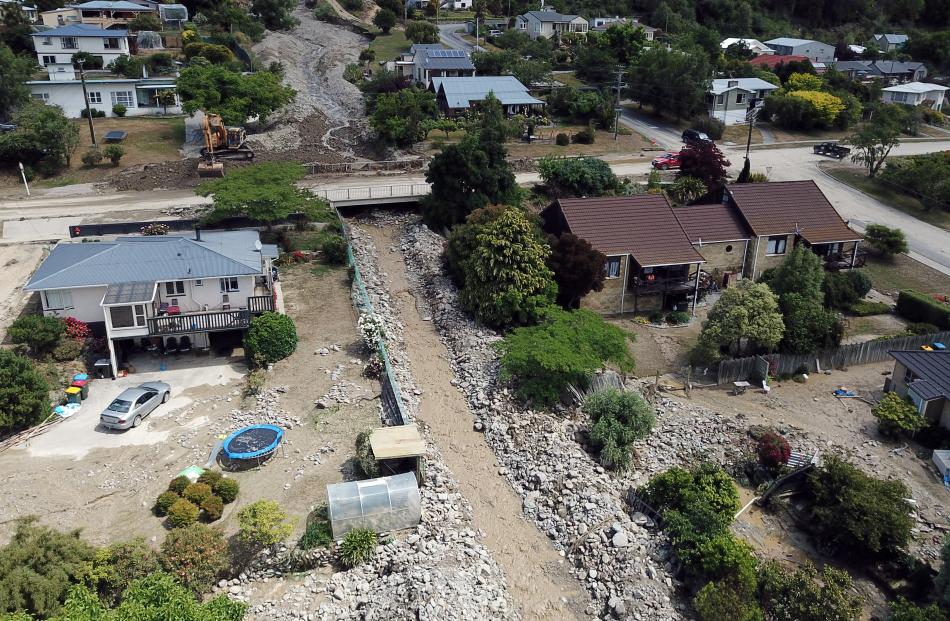 An image from a drone shows the extent of damage along Reservoir Creek, with tonnes of rocks lining the concrete culvert after Sunday's flash flood. Photo: Craig Baxter