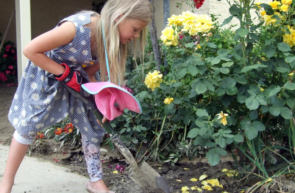 Roxburgh Area School pupil Alexina Ballantine (8) was the youngest to get dirty and help clean out one Tweed St property.
