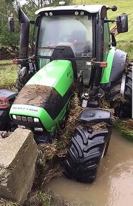 A tractor that was dumped in the creek by floodwater.