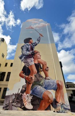 Fintan Magee's mural on the Southern Cross hotel building.