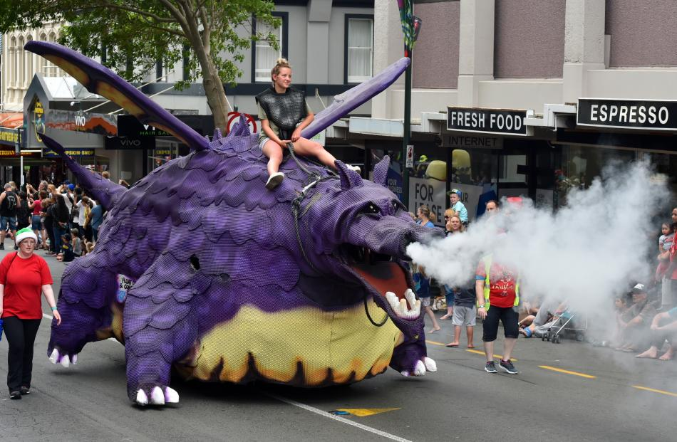 Puff the Magic Dragon blows smoke into the delighted crowd.