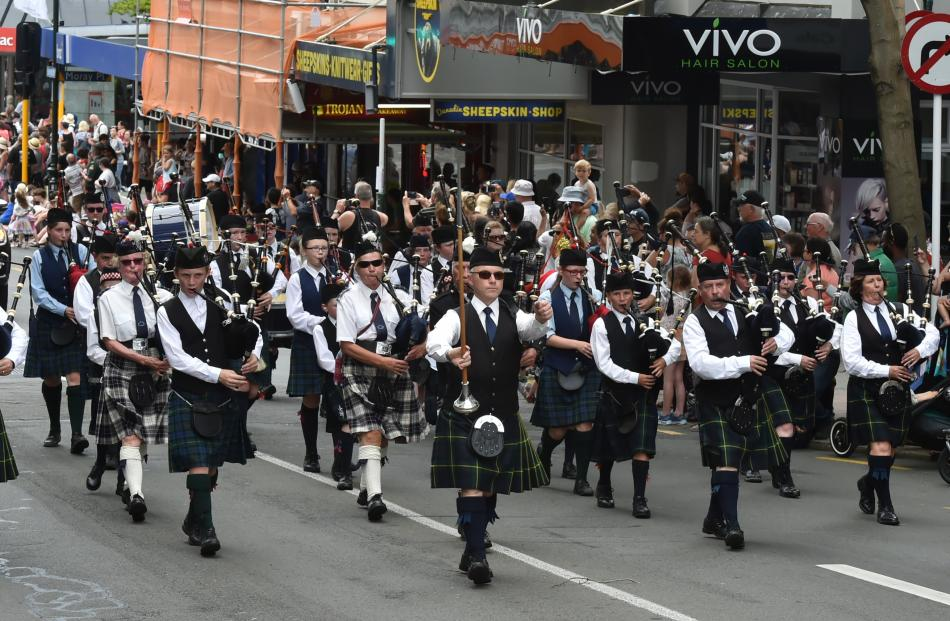The City of Dunedin Pipe Band leads the parade.
